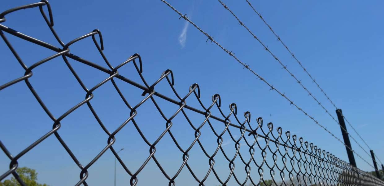 chainmesh and triple barbed wire